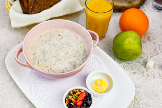 breakfast, oatmeal with butter, berries and orange juice