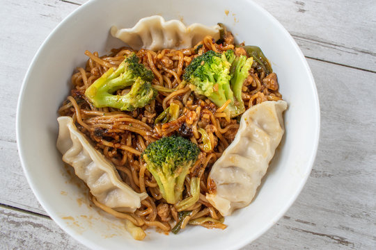 homemade lo mein noodles with broccoli and dumplings flat lay