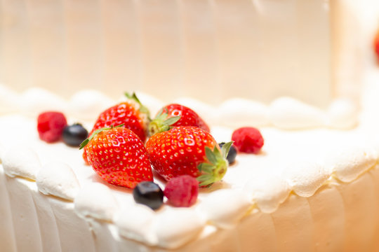 Strawberries and blueberries on the cake