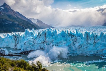 Ice collapsing into the water at Perito Moreno Glacier in Los Glaciares National Park near El Calafate, Patagonia Argentina, South America.