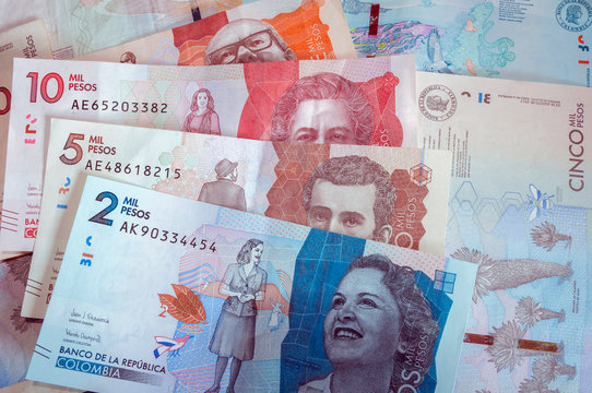 Composition with various Colombian banknotes. Paper money, cash. Two thousand Colombian pesos banknote. Current money.