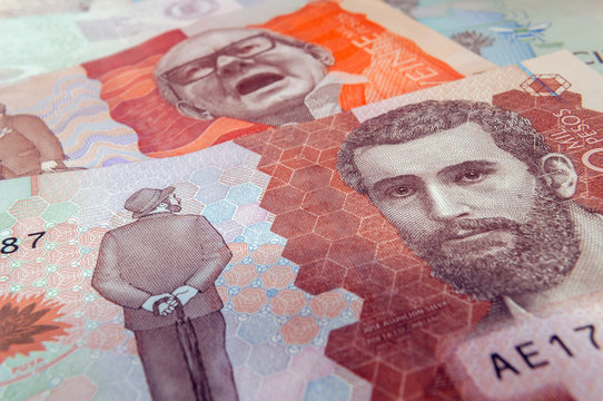 Close up of a five thousand Colombian peso banknote and a twenty thousand peso bill in the background. Colombian money. Colombia current money