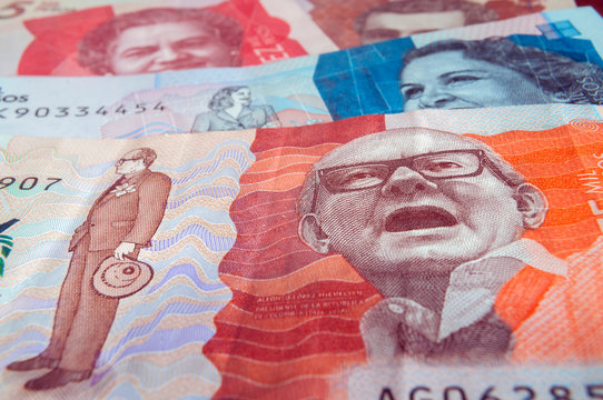 Twenty thousand Colombian pesos banknote in the foreground and others of two, five and ten thousand in the background. Colombian banknotes, Colombian money