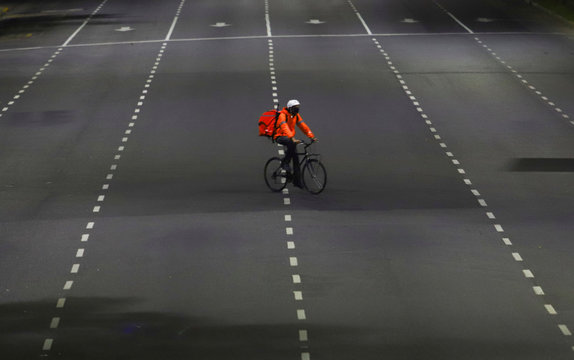 A man who works for the mobile delivery app Rappi rides his bike on the street as Argentine President Alberto Fernandez announced an extension of the lockdown it has imposed as a measure to control the spread of the coronavirus disease (COVID-19), in Bueno