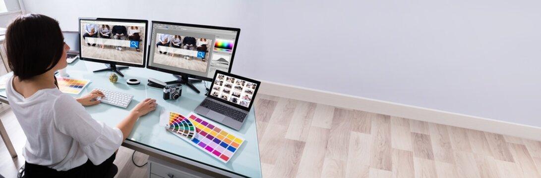 Female Designer Working On Multiple Computer