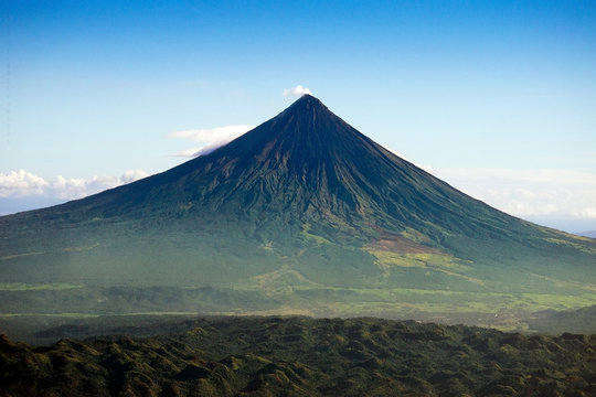 Aerial of Mt. Mayon - also known as Mayon Volcano or Mount Mayon. Found in the Bicol Region in the Philippines. Taken near Legazpi Airport.