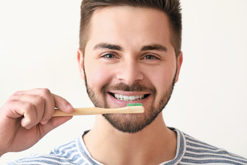 Fotomurales - Happy smiling young man with tooth brush on white background