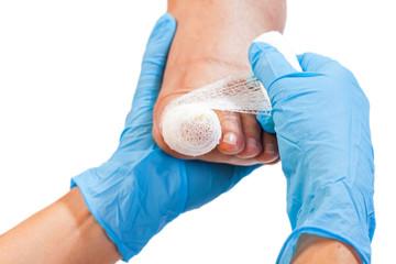 Bandaged injured toenail