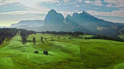 Wall Mural - Green hills in Alpe di Siusi at sunrise, aerial view