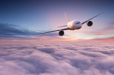 Keuken foto achterwand Vliegtuig Commercial airplane jetliner flying above dramatic clouds in beautiful light. Travel concept.
