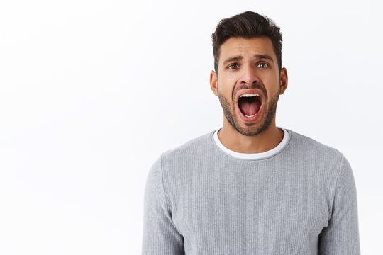 Guy thinks what happened is unfair, complaining and screaming from disappointment. Handsome cute young man with bristle whining his mom, yelling or shouting distressed, having argument