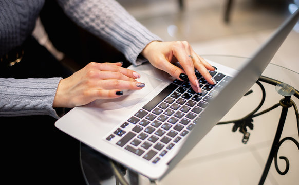 Close up woman using laptop, female hands typing, writing notes, studying languages, distance learning concept