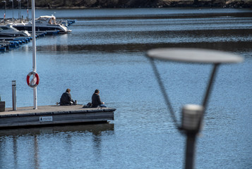 People enjoy the sunny weather on Easter Eve amid the spread of the coronavirus disease (COVID-19) in Stockholm