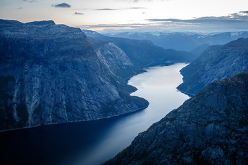 Fjord in the Norwegian mountains after sunset.