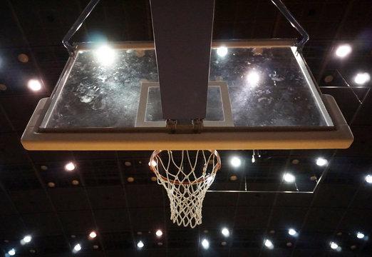 Low Angle View Of Basketball Hoop At Illuminated Stadium