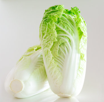 Close-up Of Bok Choys Over White Background