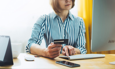 Safe online payment and electronic money transfer security. Hipster holding  credit card, women shopping online purchase internet. Pay with digital technology to internet bank. Social distance concept