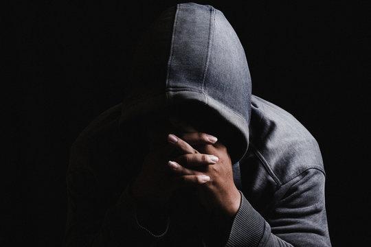 Close-up Of Sad Man Against Black Background