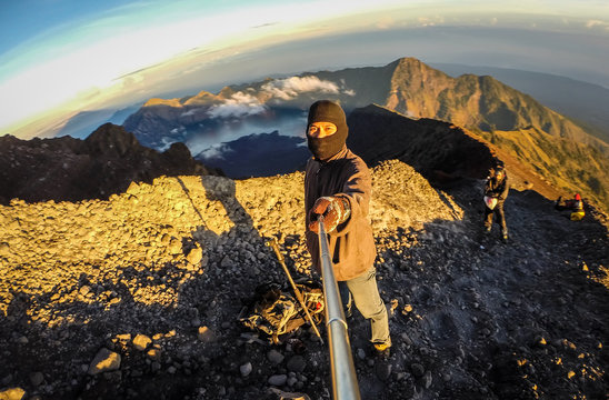 Man Clicking Selfie While Standing On Mountain
