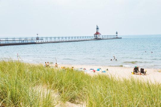 Lighthouse along sandy beach in Michigan.