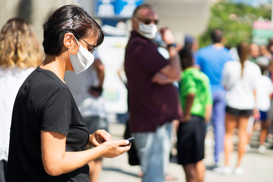 people queue with mask for coronavirus  in line up , draggle