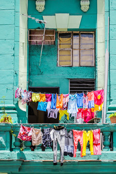Colorful Clothes Hanging On Window