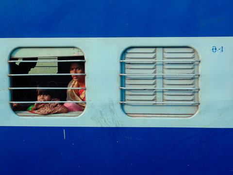Portrait Of Mother And Daughter Seen Through Train Window