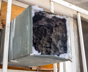 Old air duct filled with dust and dirt