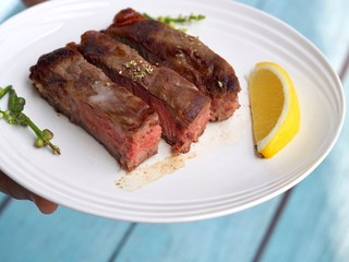 Wall Murals Ready meals Juicy Beef chops steak decorate with lemon