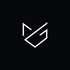 Fototapeta Minimal elegant monogram art logo. Outstanding professional trendy awesome artistic MG GM initial based Alphabet icon logo. Premium Business logo White color on black background obraz
