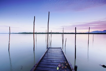 Wooden Jetty In Lake Against Sky