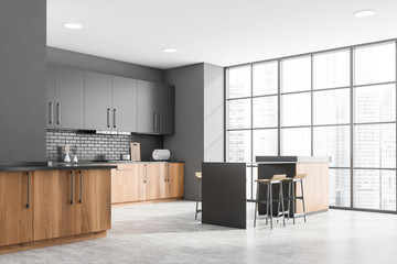 Photo sur Toile Les Textures Gray and wooden kitchen corner with bar