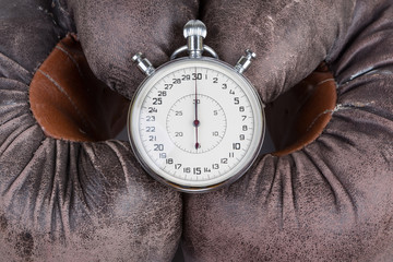 old boxing gloves with stopwatch