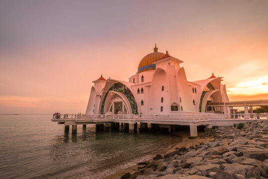 Melaka Straits Mosque By Sea Against Sky During Sunset