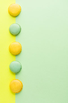 Directly Above Shot Of Macaroons On Colored Background