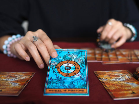 tarot card reading wheel of fortune teller astrologer divination selected focus
