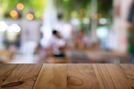 Close-up Of Wooden Table Against In Restaurant