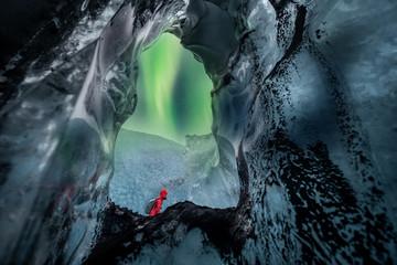 Wall Mural - Northern lights aurora borealis over glacier ice cave.