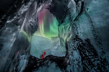 Fototapete - Northern lights aurora borealis over glacier ice cave.
