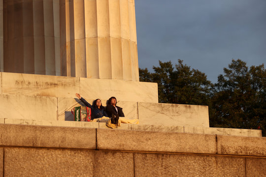 A young couple pray at Easter sunrise at the Lincoln Memorial during the coronavirus disease (COVID-19) outbreak in Washington