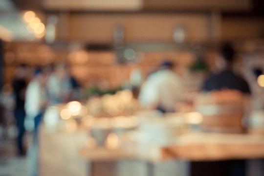 Defocused Image Of People In Restaurant