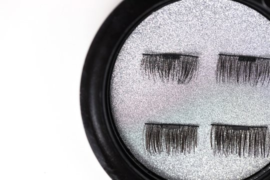 Artificial eyelashes on a magnet on a white background