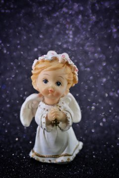 figurine angel with wings on a black background