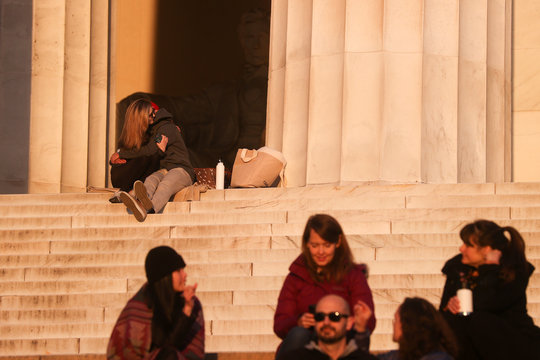 A couple embrace as a few people take to the steps at the Lincoln Memorial during the coronavirus disease (COVID-19) outbreak, where normally thousands of Christians would gather for worship at Easter sunrise, in Washington