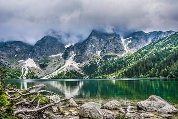 Fototapeta Scenic View Of Lake By Mountains Against Sky obraz