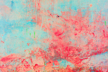 Old concrete wall covered with colorful paint