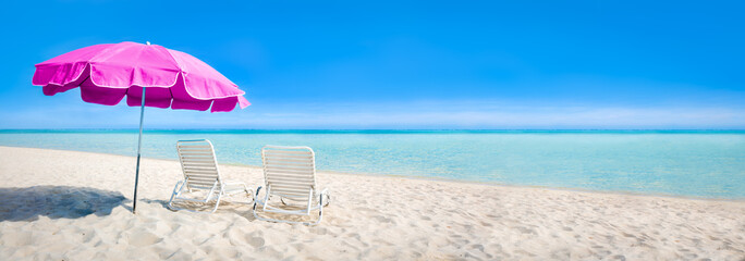 Wall Mural - Beach panorama with sun chair and parasol as background image