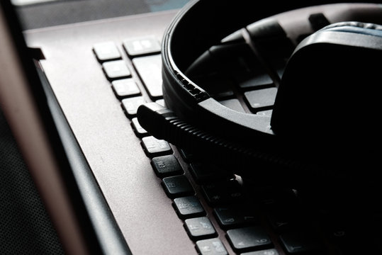headphone on the laptop keyboard for background
