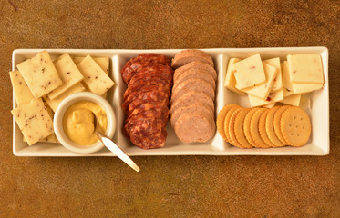 Rectangular Serving Plate of Cheese, Crackers, Meats, and Mustard