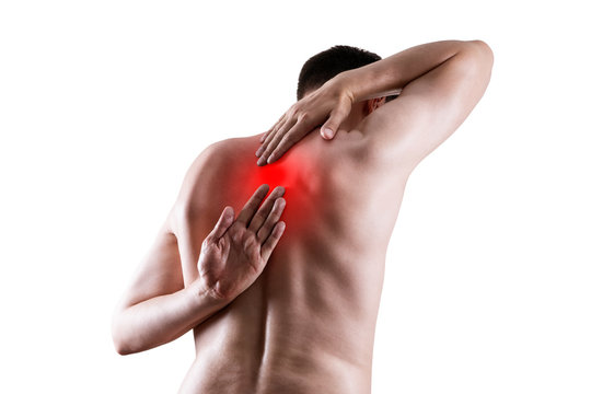 Pain between the shoulder blades, man suffering from backache isolated on white background